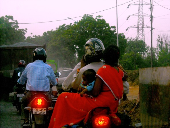 Family of 3 on a mtorcycle