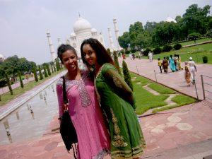 Smiling in front of the Taj Mahal